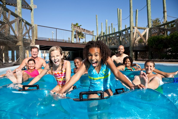Smiling-group-at-water-park-in-innertubes-000016458661_XXXLarge