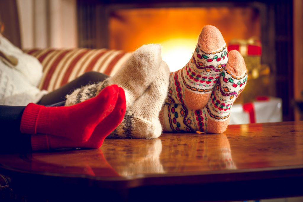 Christmas family with their feet up by the fire for Element Last Minute Christmas Prize Promotion