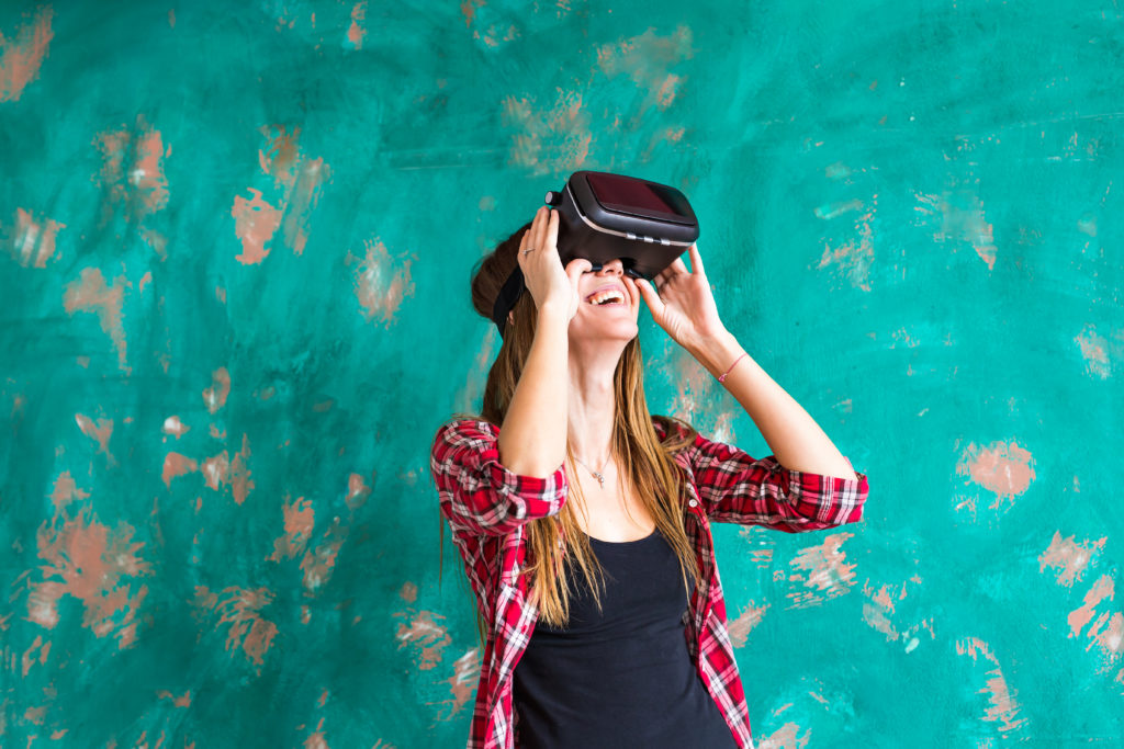 woman using a virtual reality device to illustrate sales incentives ideas   Element - The Prize & Incentive People