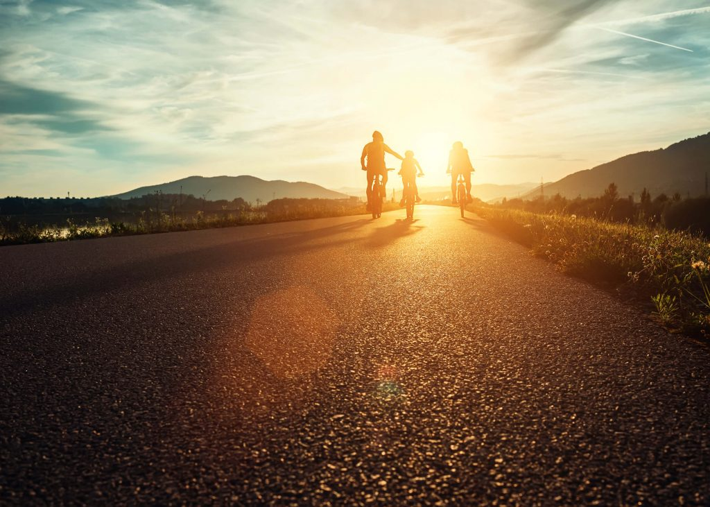 Incentive Rewards: Family Cycling into Sunset | Element - The Prize & Incentive People