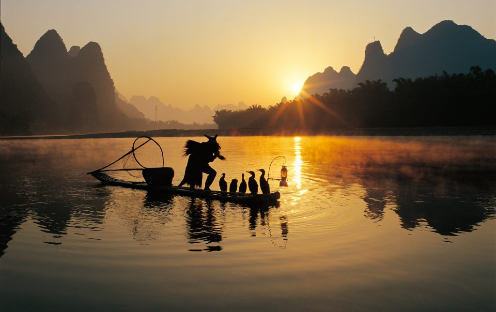 Dream Incentive Destination: Guilin in China, Man fishing with an osprey   Element - The Prize & Incentive People