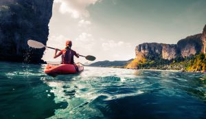 Kayaker celebrating a gaming incentives promotion & reward | Element - The Prize & Incentive People