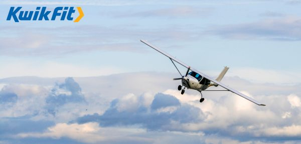 Plane flying to illustrate Kwik Fit internal incentive trips | Element - The Prize & Incentive People
