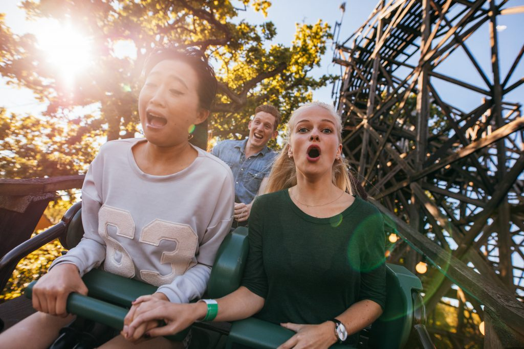 Two girls on a rollercoaster to illustrate Element Halloween Prizes 2017