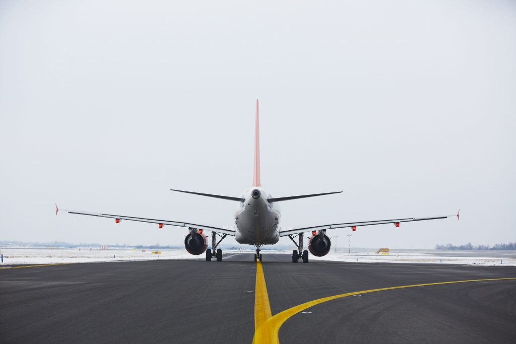 Airplane is taxiing on the airport in winter to illustrate Flying Home for Christmas Incentive | Element