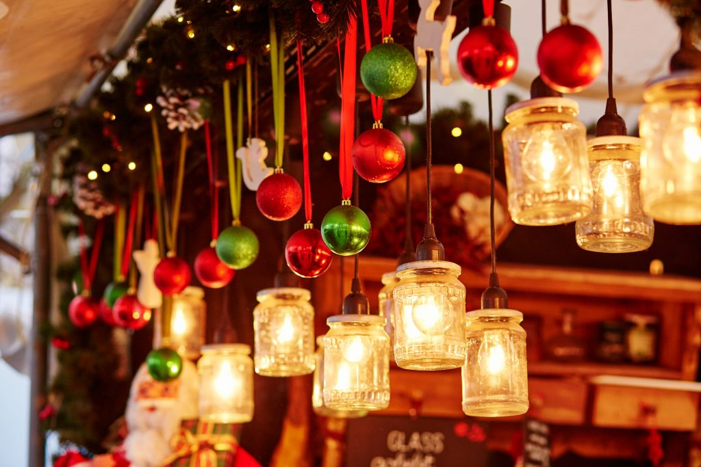 Colorful Christmas decorations and glass lanterns on a Parisian Christmas market to illustrate Luxury Christmas Market Breaks christmas incentives | Element