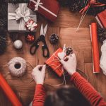 Woman wrapping a present to illustrate gadgets and gifts for Christmas Incentives | Element